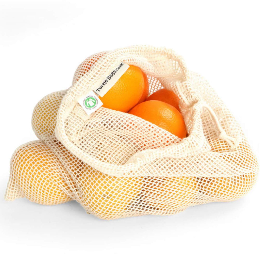 Large bulk produce bag with oranges inside