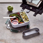 olive color lunch box tupper with cutlery with salad inside