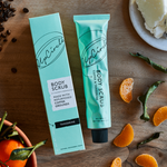 Upcircle body scrub next to tangerine