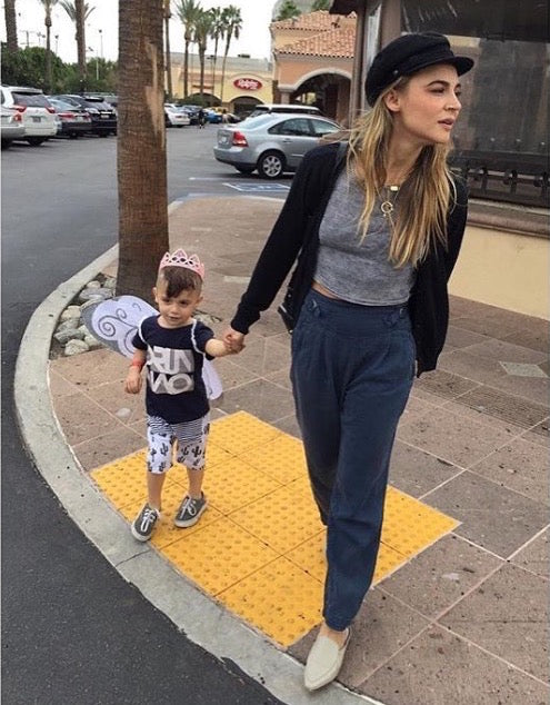 Samaire Armstrong wearing LOU.EARL shoes crossing the street with her son