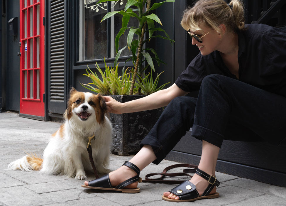 creative shoe designer in United States pictured with her dog.