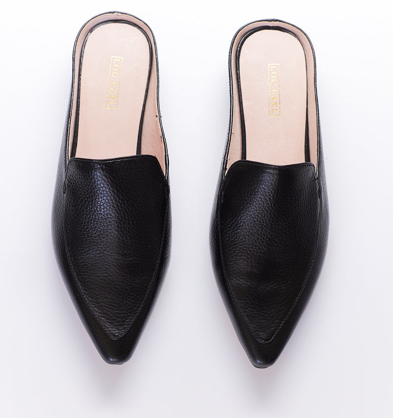 pointed toe classic mule loafers for women with tumbled leather upper and light tan leather lining.