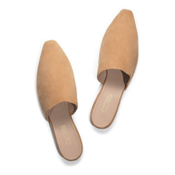 tan soft suede flat mule shoes for women. featuring an almond shaped toe and light tan leather insole with gold foil logo.