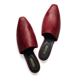 Red wine-colored diamond-shaped laser cut leather flat mule shoes with soft square shaped toe. Lining is black leather with gold logo at cushioned heel.
