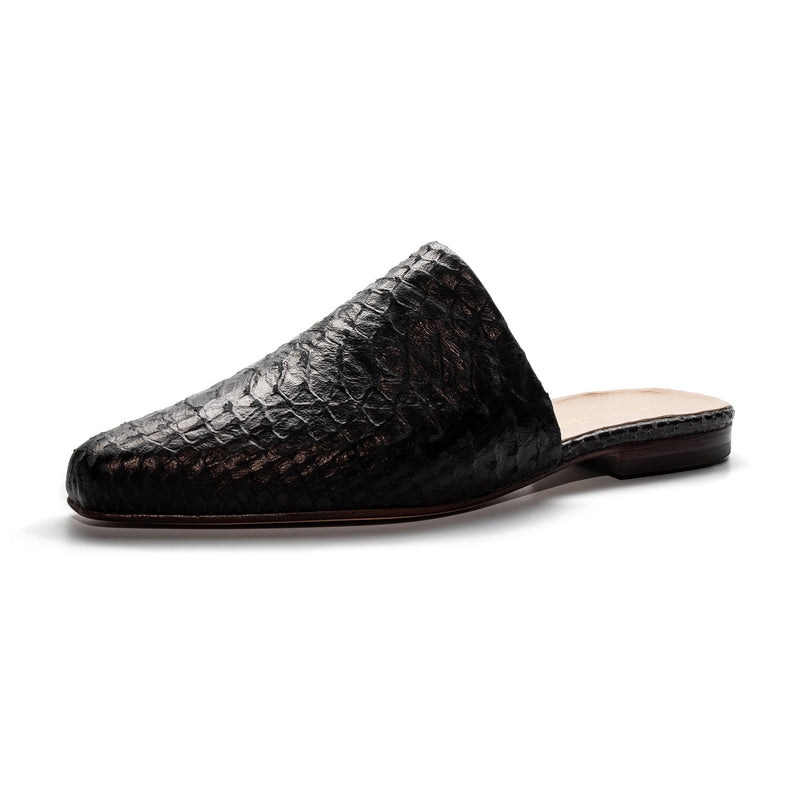 Side view of Lou earl reptile-embossed leather flat mules for women.