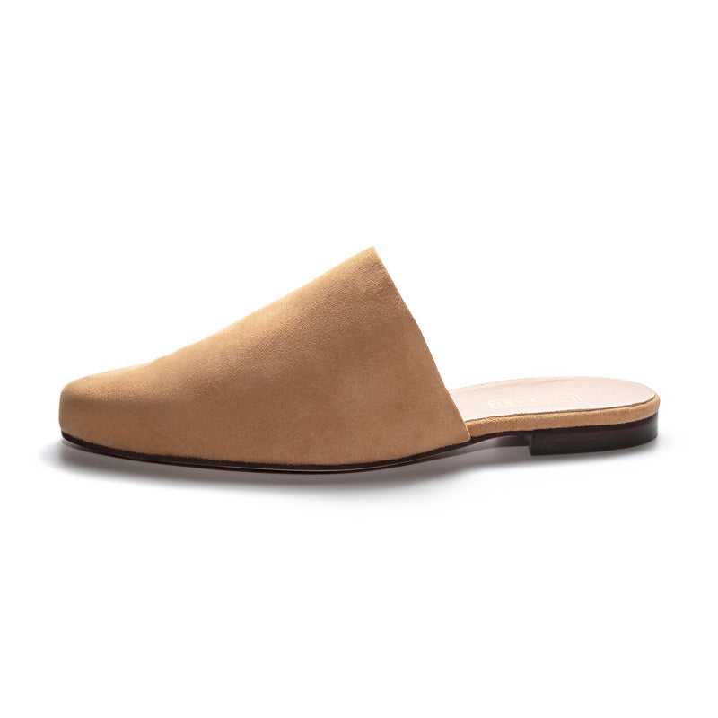 a side profile photo of soft camel tan colored suede mules for women with flat insole. upper shows no stitching. handmade in Los Angeles, California.