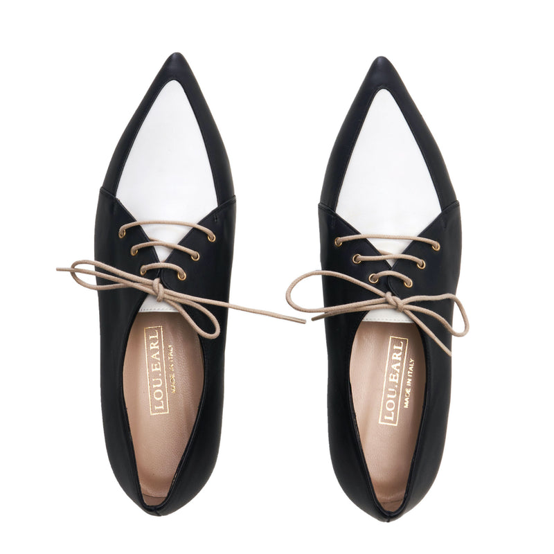 menswear inspired black and white two tone Oxford shoes for women. lace up, pointed toe style made in italy