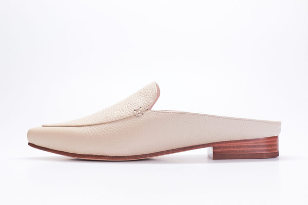 oyster colored tumbled leather mule slides with plain vamp and stacked brown heel.
