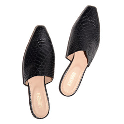 Black snake-embossed flat mule shoes for women with delicate square toe. Lining is nude-colored smooth leather with gold logo at heel. Heel is padded.