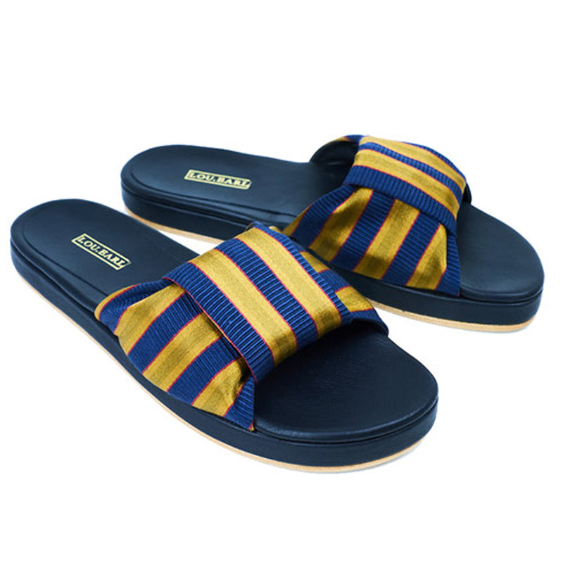 Navy and gold striped womens bowtie leather sandals with contoured footbed and gold logo.