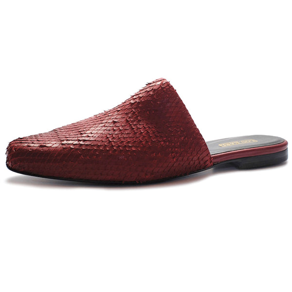 Oxblood colored leather flat mules with low heel. Vamp leather is laser-cut and offers slight texture.