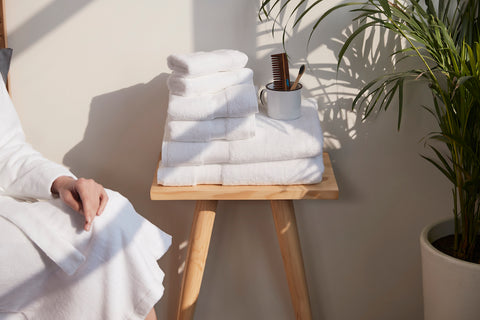 A side table with white color organic cotton towel set