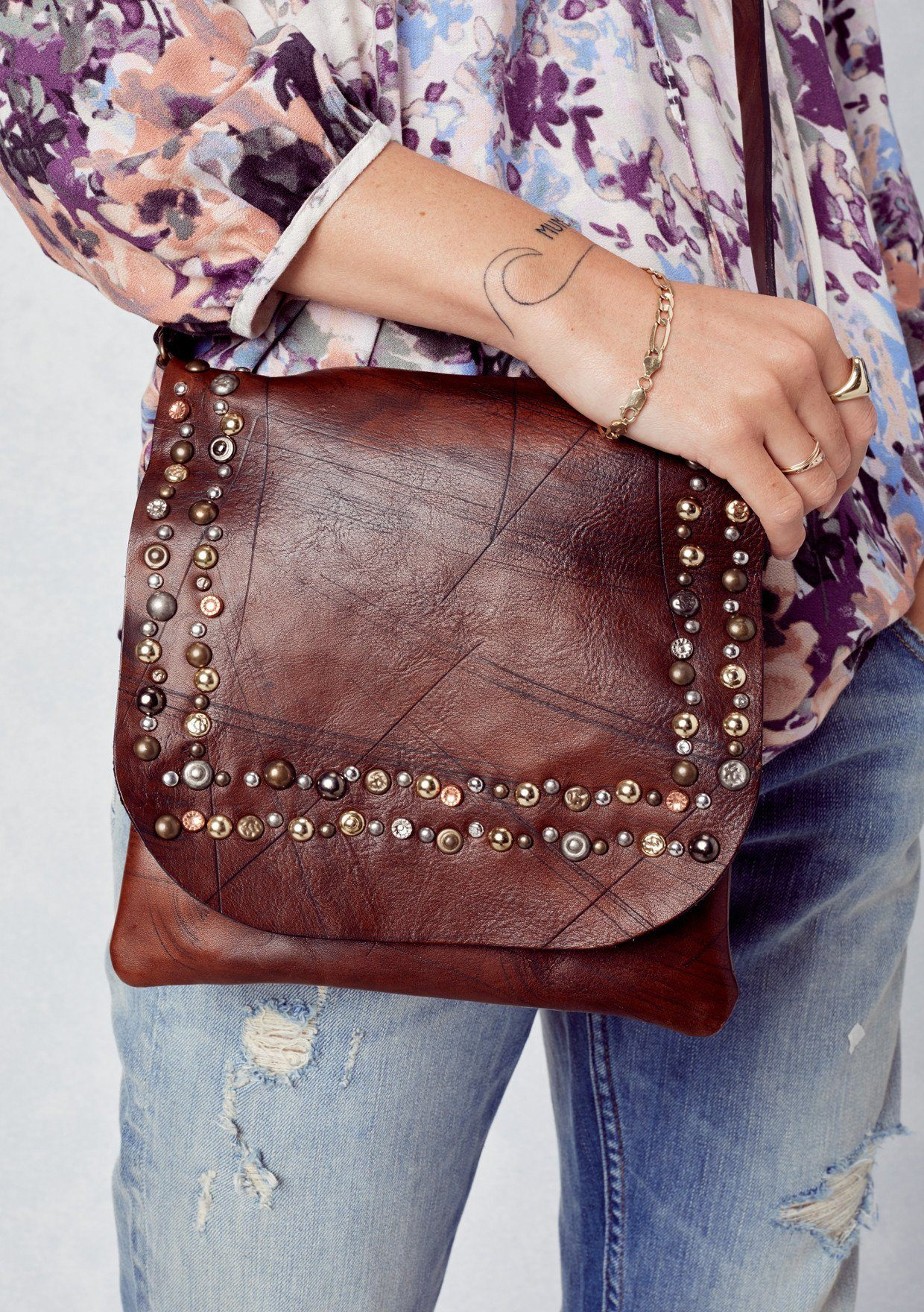 [Color: Cognac] Lovestitch leather crossbody bag with metal studded flap and long leather strap.