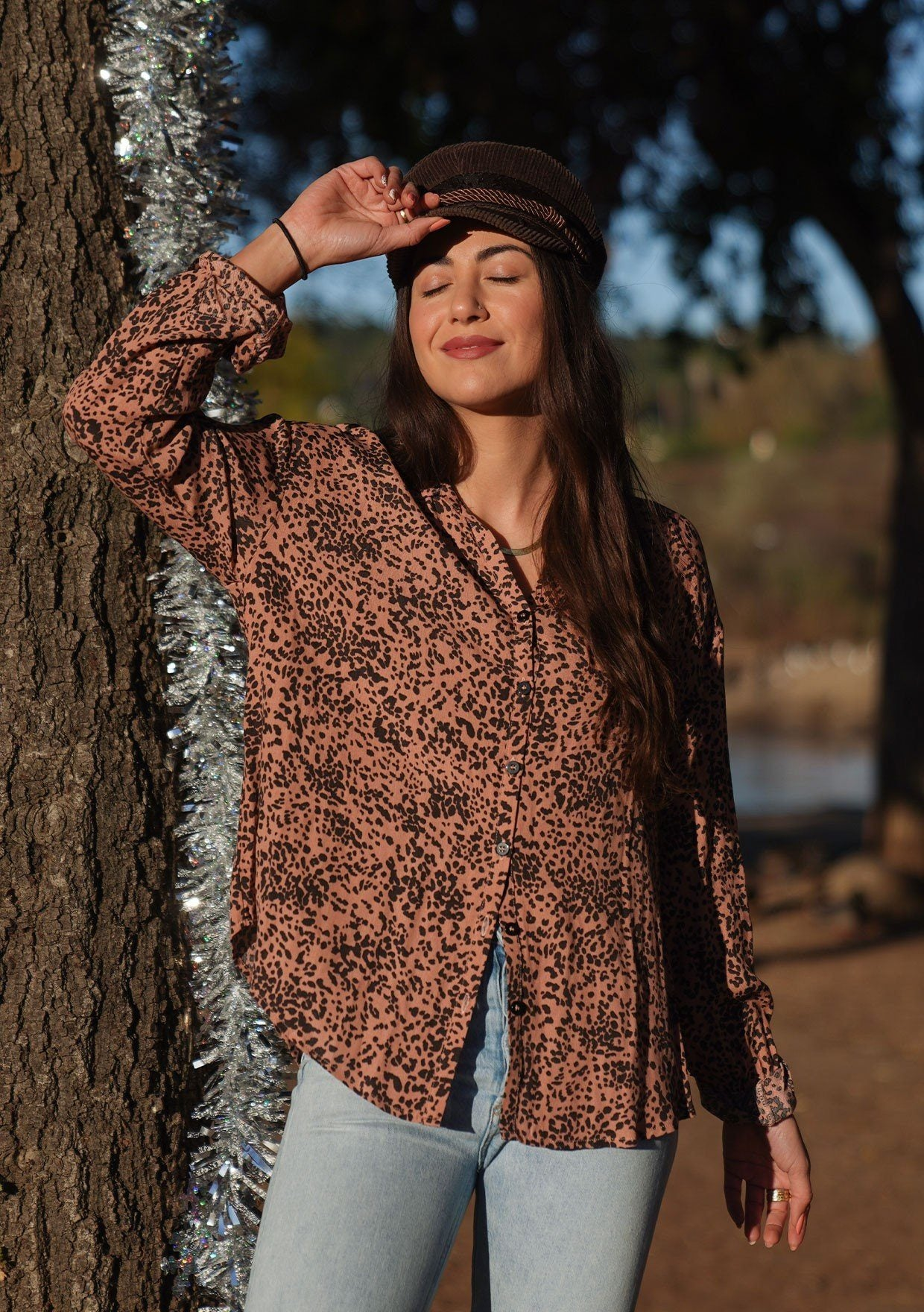 [Color: Hazel Black] Button up blouse in an abstract animal print. An elegant style featuring a flattering oversize relaxed fit, a button cuff wrist, and a breezy double keyhole detail at the back. Pair it with jeans for a casual vibe, or dress it up with a skirt for a bohemian chic look.