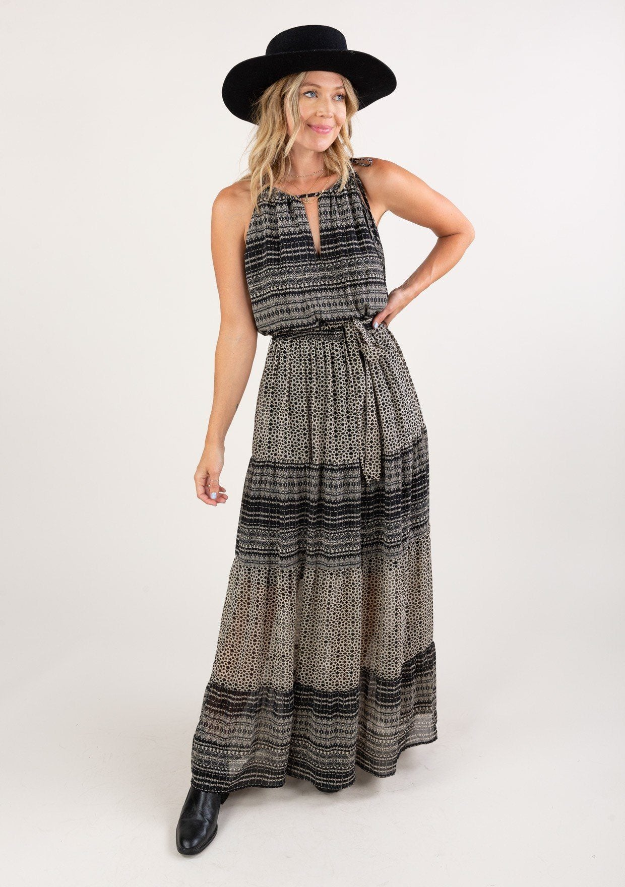 [Color: Black Cream] Embrace the romance of Fall in our bohemian sleeveless maxi dress in a mixed geometric print. Featuring a trending drawstring neckline, an elastic waist with a self tie belt for definition, and a flirty tiered skirt. An essential maxi style for all your Autumn escapades.