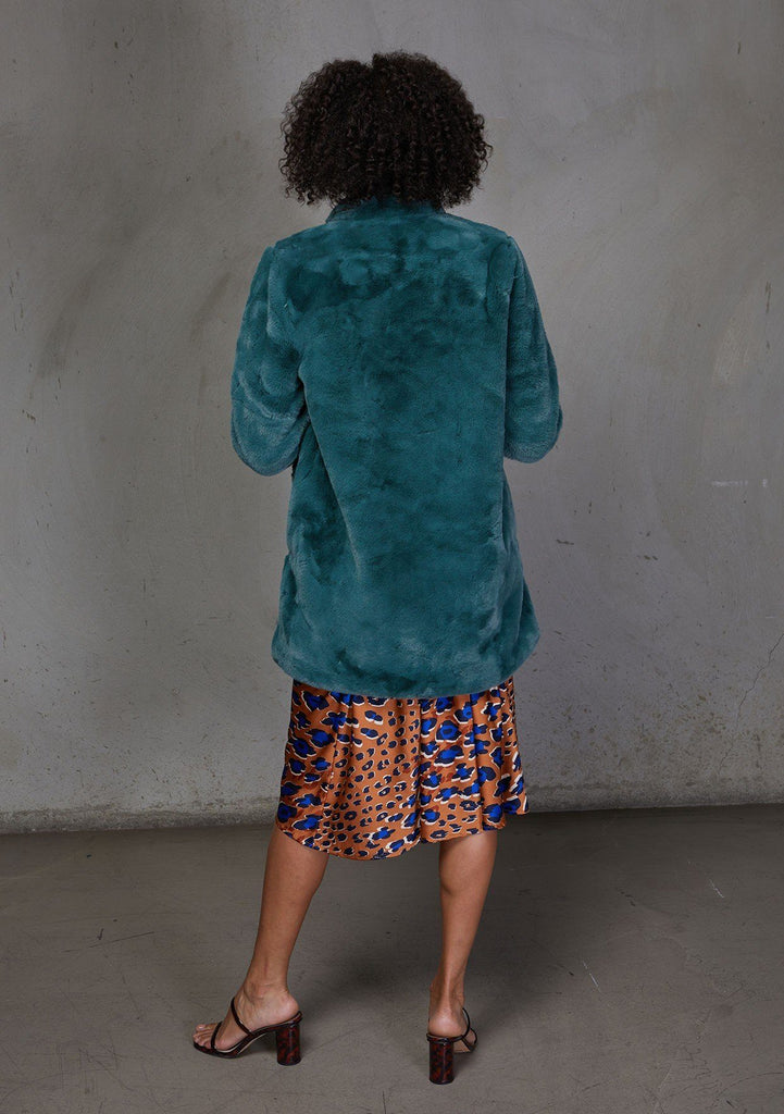 [Color: Vintage Pine] An ultra luxe faux fur statement coat in bright bold color. Featuring essential side pockets, a silky lining, and a soft hand feel. Styled here with a leopard print slip dress.