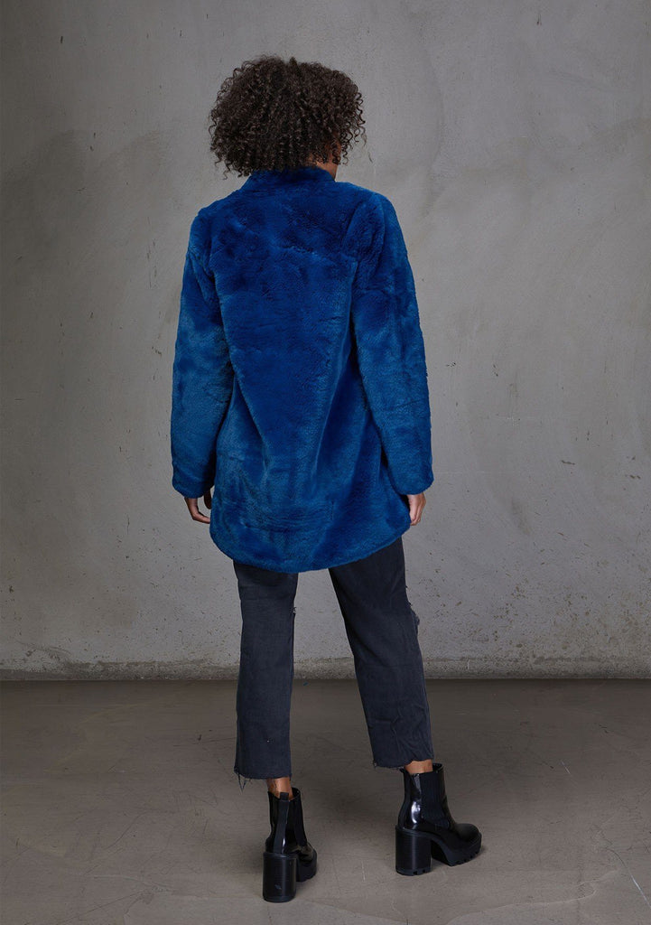 [Color: Electric Teal] An ultra luxe faux fur statement coat in bright bold color. Featuring essential side pockets, a silky lining, and a soft hand feel.