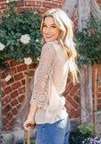 [Color: Stone] Bohemian flowy top featuring pretty crochet bell sleeves and a crochet neckline detail.