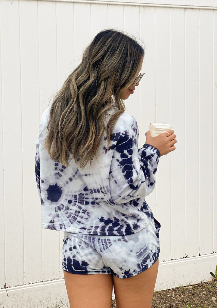 [Color: White/Indigo] Girl wearing a blue tie dye lounge hoodie.