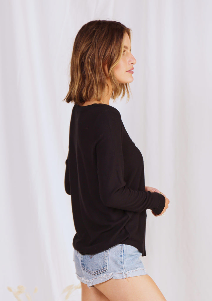 [Color: Black] Girl wearing a micro rib black long sleeve top.