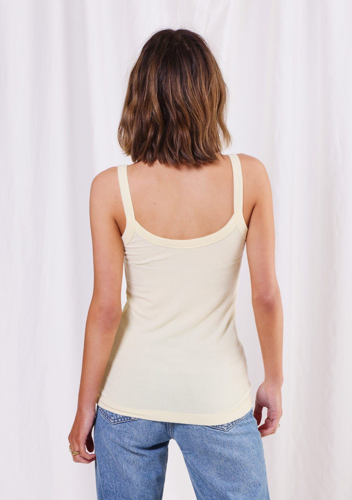 [Color: Lemon] Girl wearing a micro rib yellow sleeveless tank top.