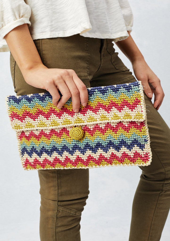 [Color: Fuchsia/Navy] Lovestitch natural & fuchsia, lightweight, zig-zag patterned raffia clutch with single button closure.