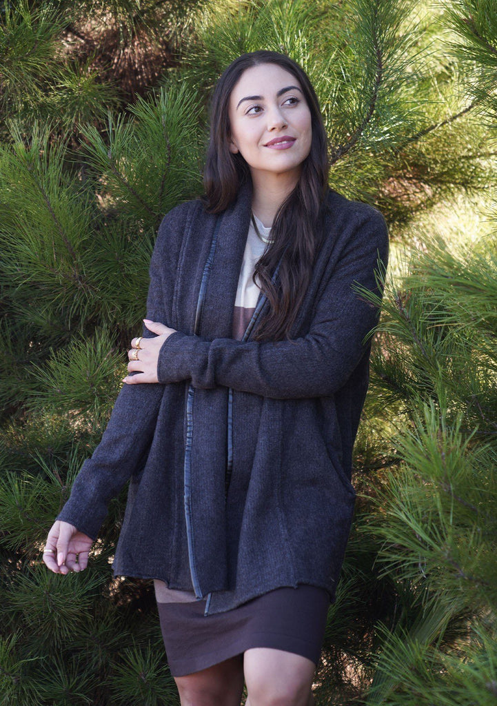 [Color: Charcoal] A cozy cardigan sweater, featuring essential side pockets and a chic vegan faux leather trim.
