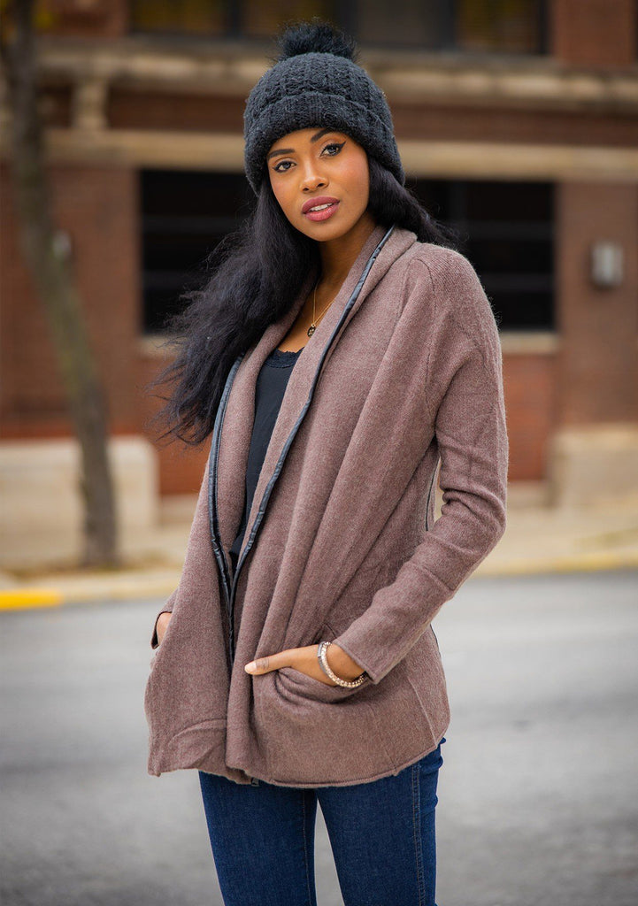 [Color: Mahogany] A cozy cardigan sweater, featuring essential side pockets and a chic vegan faux leather trim.
