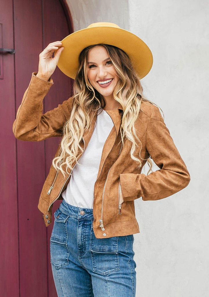[Color: Camel] Add a western touch to any Fall outfit in our vegan suede motorcycle jacket. An essential Autumn style that features a slim fit, a classic notched collar, and a back fringe detail. Pair it with blue jeans for a classic look, or layer it over a dress with boots for a bohemian vibe.