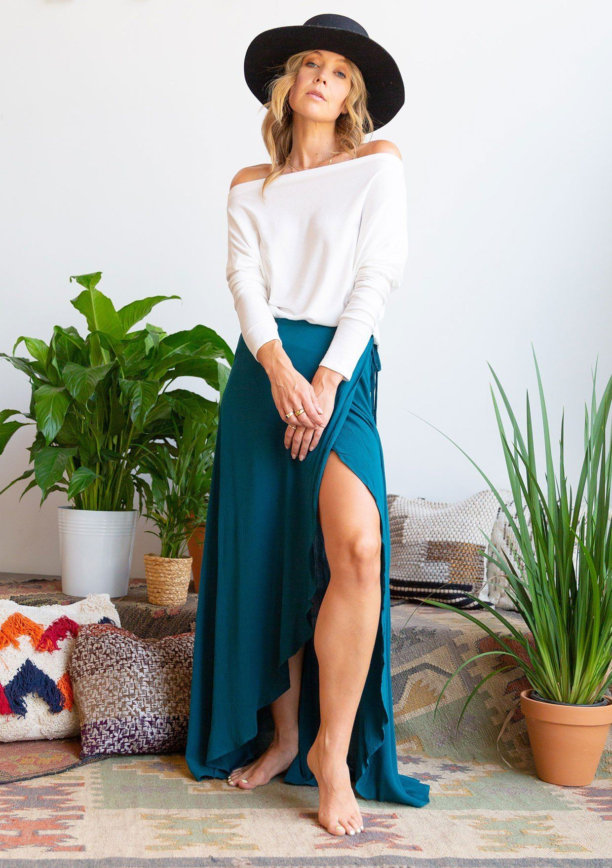 [Color: Peacock] Billowy, romantic maxi wrap skirt. Featuring a long flowy silhouette, a sexy high slit, and a side tie closure at the waist. Worn here with a long sleeve tee.