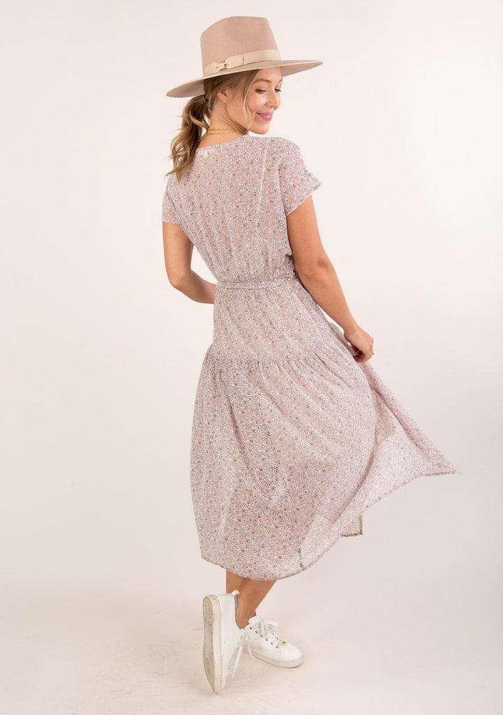 [Color: Blush Ivory] Gorgeous seventies inspired floral ditsy midi dress. A smocked elastic detail in the back waist adds definition.