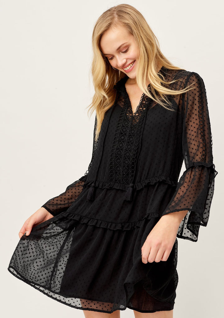 [Color: Black] Lovestitch bohemian chic sheer black swiss dot mini dress with long bell sleeves and a split V neckline with crochet hem.