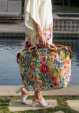 [Color: Multi/Natural] A fashionable and functional weekender bag with a bright multi color embroidered front. Featuring zippered closure, suede handles, and a long removable adjustable leather strap for easy carrying.