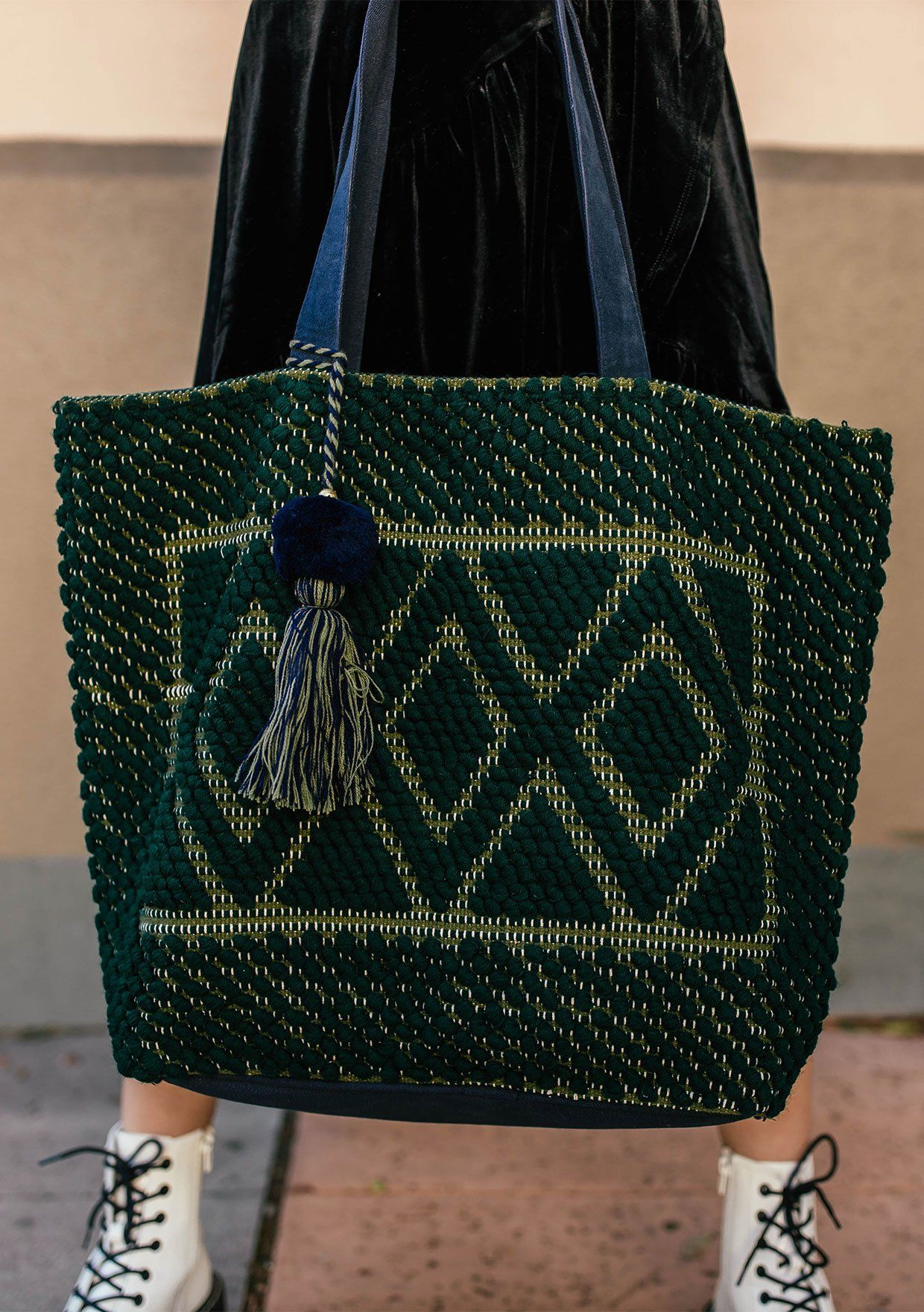 [Color: Forest Navy] A totally groovy bag for all your adventures. This bohemian tote features a diamond woven pattern and pompom tassel accents.