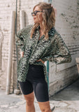 [Color: Army Black] Bring out your inner wild child with our sheer leopard print button up shirt. Featuring a classic collared neckline, a button up front, and a relaxed, slightly oversize fit. Layer this sheer top over a bralette for a night out, or pair it with bike shorts for a trendy look.