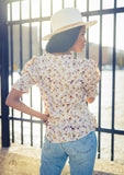 [Color: Dusty Blush] Sweet and silky button front top in a pretty mini floral print. Featuring elbow length puffed sleeves, a waist defining cinched back, and a flattering flared waist.