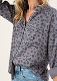 [Color: Grey Leopard] We are wild about this classic button up shirt in an allover cheetah print. Featuring a long sleeve with button tab closure and two front pockets. This top is both comfortable and fashionable.