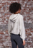 [Color: Stone] A soft lounge hooded sweatshirt featuring subtle distressed details, flattering dolman sleeves, and a slouchy hoodie. Styled here with jeans.