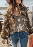 [Color: Olive/Rosewater] A bohemian blouse in a pretty floral print. Featuring elegant and flattering voluminous lantern sleeves, a split neckline with tassel ties, and flirty ruffle details.