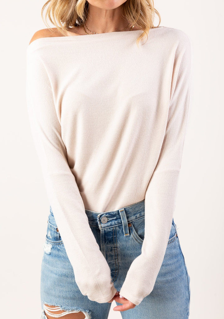 [Color: Sand] Take your basics to the next level with our elegant off shoulder long sleeve tee in a soft micro rib knit. A classic style featuring long dolman sleeves, a boat neckline, and a center back seam detail. A not so basic tee with an incredibly soft hand feel, try it worn on or off the shoulder.