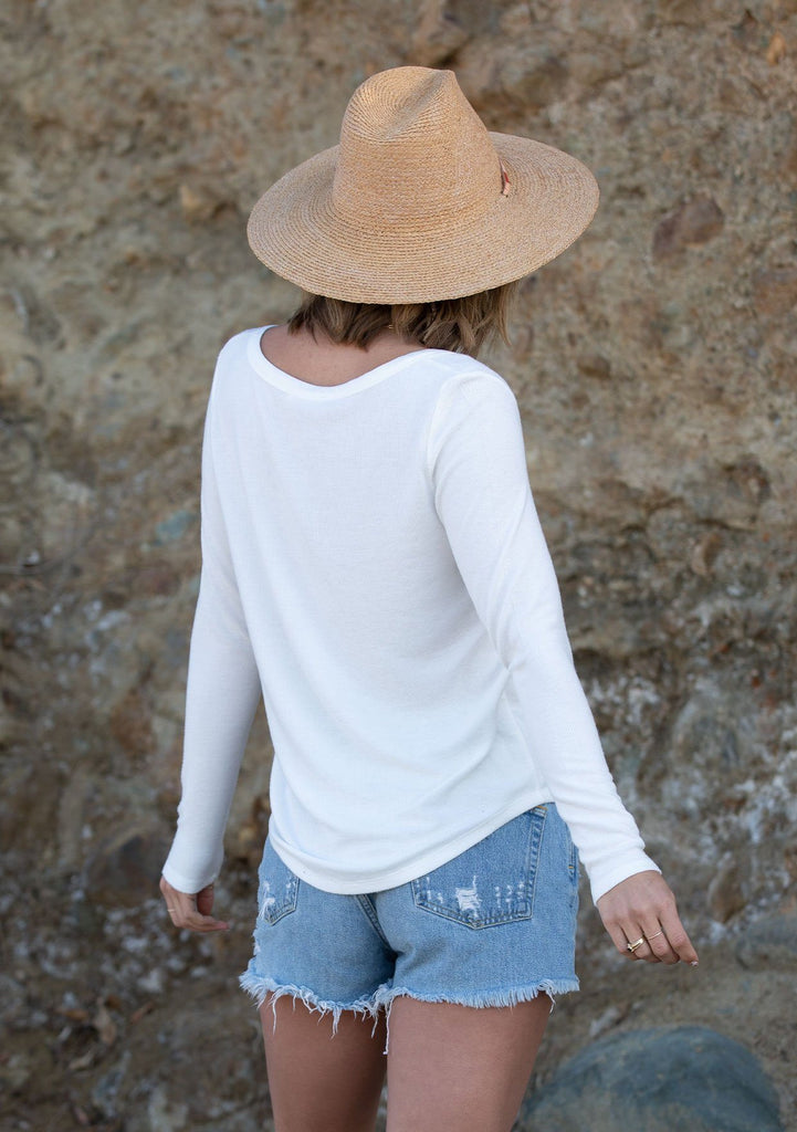 [Color: White] Girl wearing a micro rib white long sleeve top.