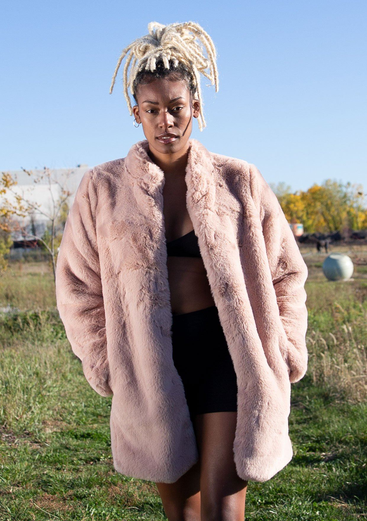 [Color: Blush] Ultra luxe faux fur statement coat in a soft pretty pink. Featuring essential side pockets, a silky lining, and a soft hand feel.