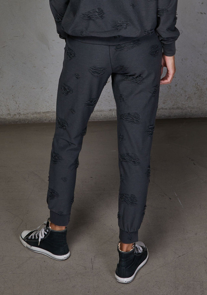 [Color: Charcoal] Relaxed, super soft jogger pants with cool distressed details. Featuring essential side pockets, a slightly tapered leg, and an elastic waistband.