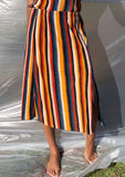[Color: Black/Spice/Teal] A striped pleated midi skirt. Featuring a front slit.