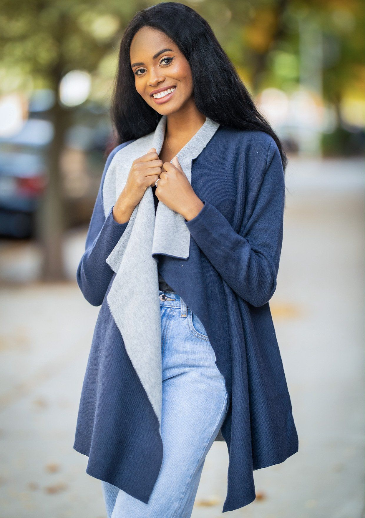 [Color: Navy Heather Grey] A two tone cardigan featuring a wide lapel, a contrast interior, and the perfect mid length hemline.