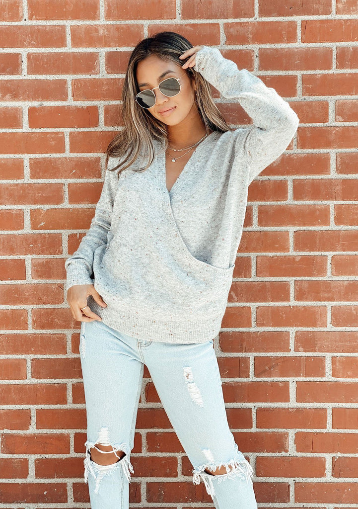 [Color: Grey Confetti] Speckled cross front sweater. Featuring a flattering v neckline and a whimsical confetti speckle throughout.