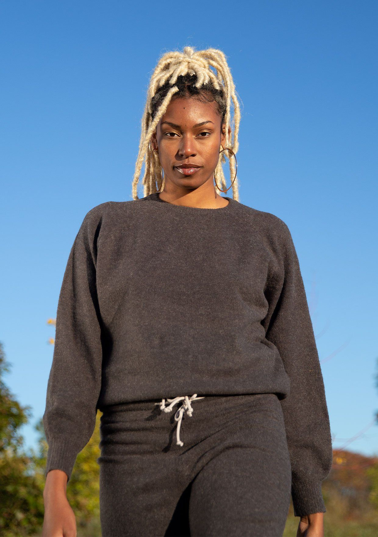 [Color: Dark Charcoal] A wool blend pullover sweater featuring long raglan sleeves, a classic crew neck, and a drawstring waist.
