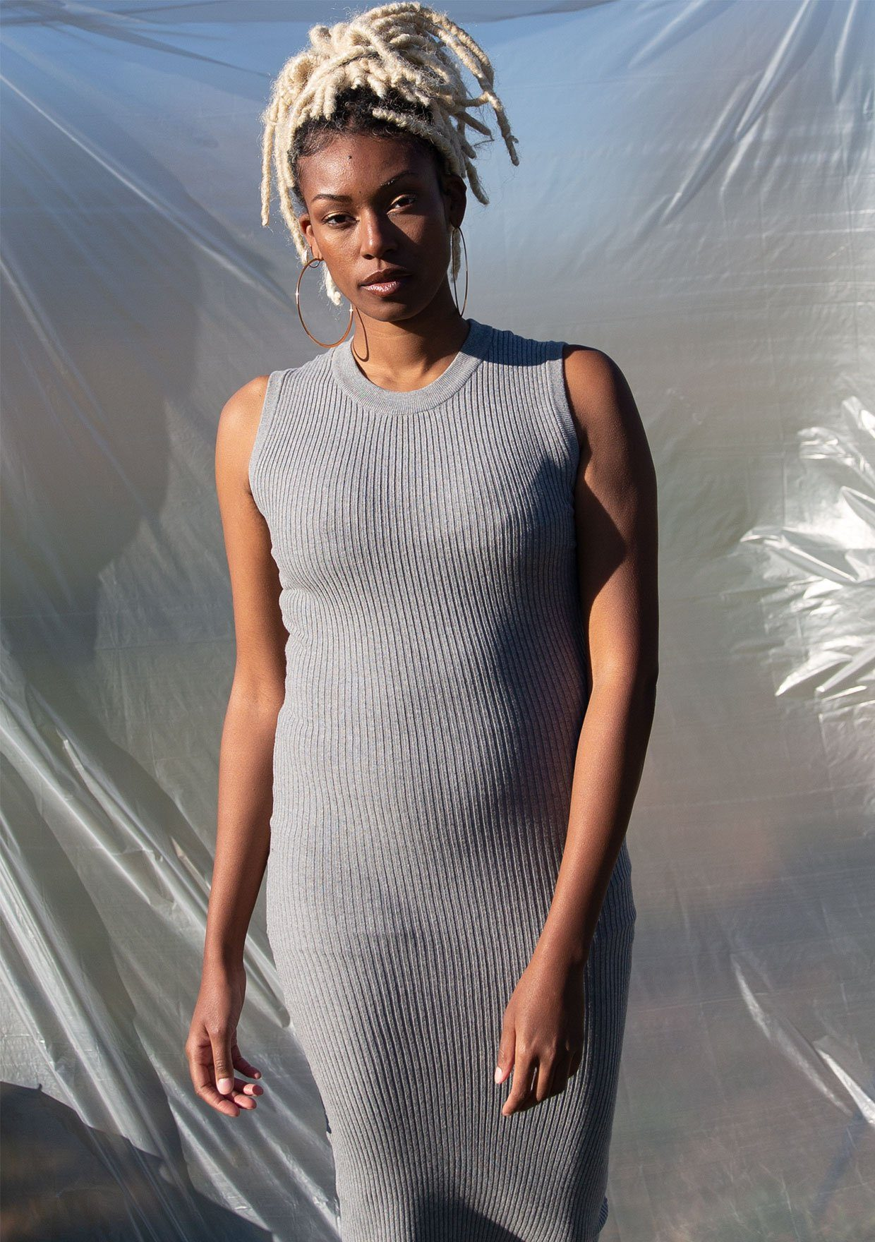 [Color: Light Heather Grey] Elevate your sweater dress game with our effortlessly chic sleeveless ribbed bodycon dress! A touch of stretch gives this midi dress an easy slim fit and helps to maintain its shape.