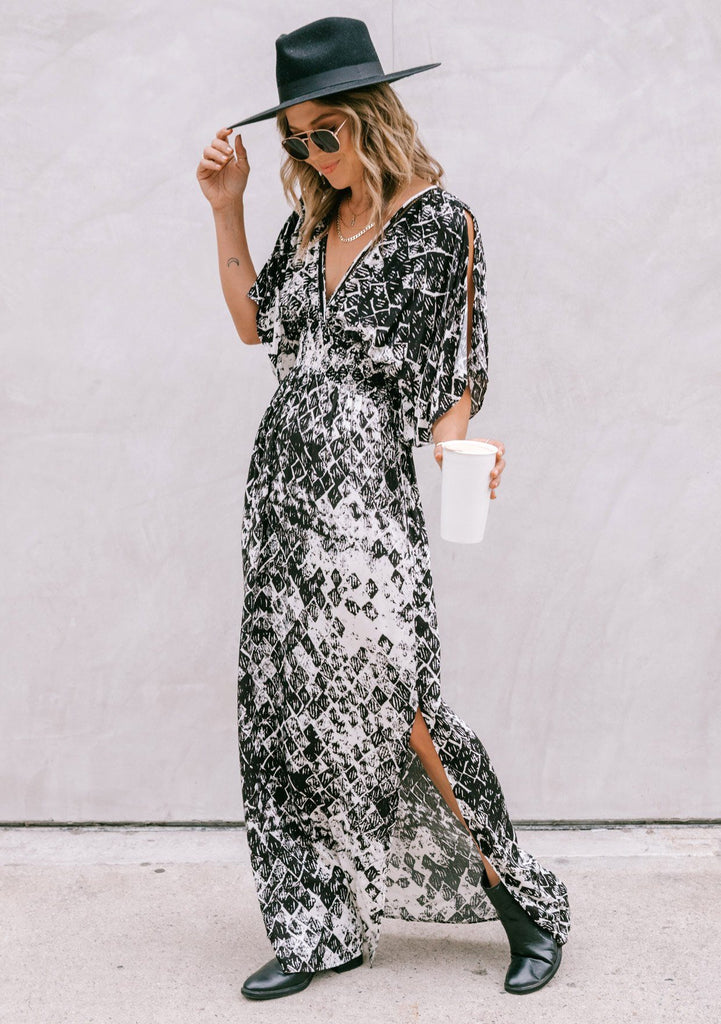 [Color: Black Combo] Girl wearing a bohemian maxi dress featuring shoulder cut-outs and kimono sleeves