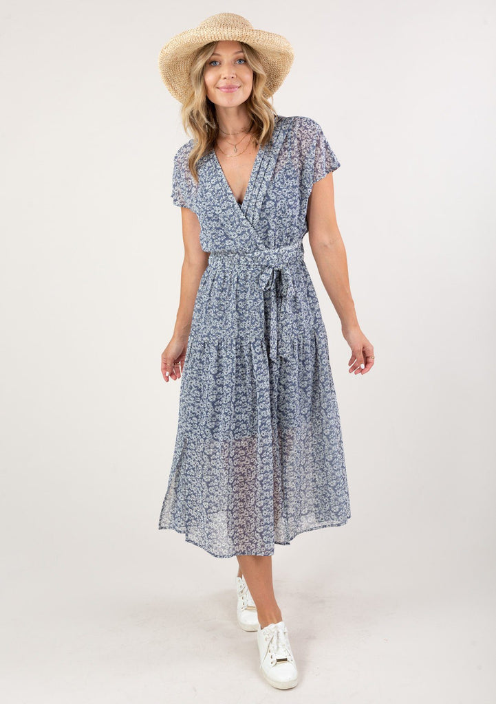 [Color: Denim Ivory] Gorgeous seventies inspired floral ditsy midi dress. The sexy side slits add movement.